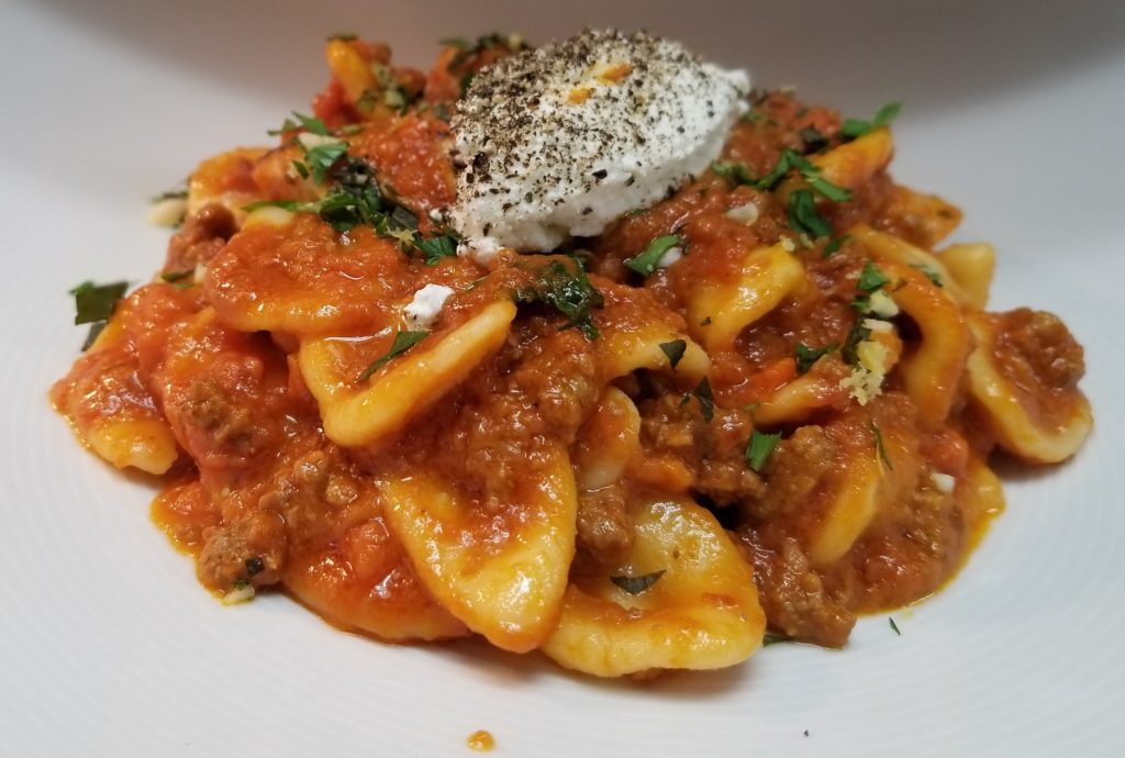 Fresh Orecchiette Pasta, American Lamb and Guanciale Bolognese, Peppered Ricotta, Mint Gremolata