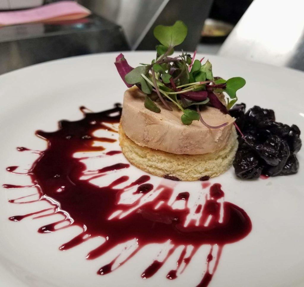 Torchon of Duck Foie Gras, Brioche Toast, Sour Cherry, Fig and Port Wine Reduction