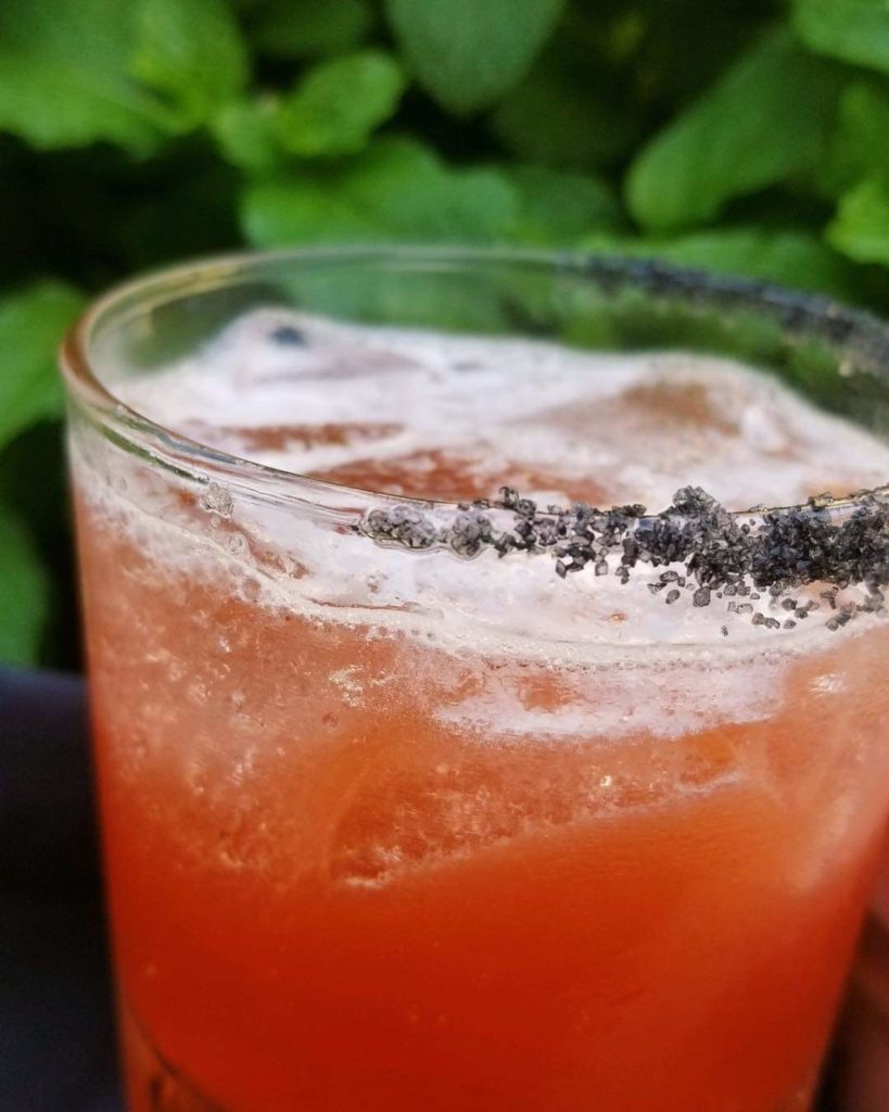 El Jimador Reposado Tequila, House-Made Local Strawberry Syrup, Fresh Lemon and Lime  Juice, Black Lava Salt