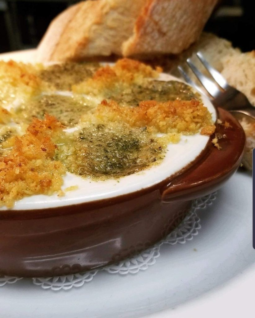 Bistro Style Escargot with French Helix Snails, Shallot, Garlic, White Wine, Cognac, Parsley, Nutmeg and Butter. Served Au Gratin in a Classic Dish